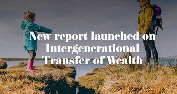 Woman and child reach across stream - image used for report on intergenerational transfer of wealth in Ireland