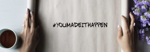 #YouMadeItHappen hashtag on rolled up paper