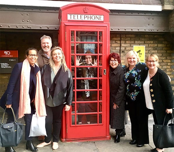 Australian legacy fundraisers outside a red UK phone box