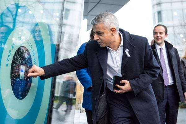 Mayor of London Sayed Khan makes a contactless donation. Photo: Tap London