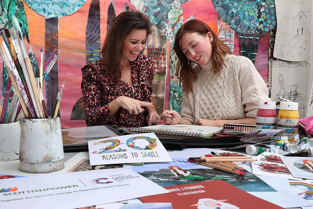 Deborah James and Aimee Ferrier amid designs