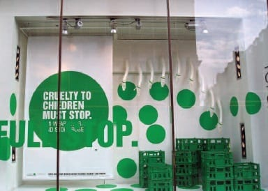 Topshop window with NSPCC Full Stop campaign display