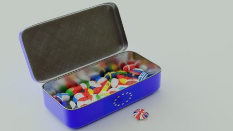 Brexit: UK button outside a blue EU-flag bearing tin containing buttons with flags of European Union 27 member countries. Photo: Pixabay.com