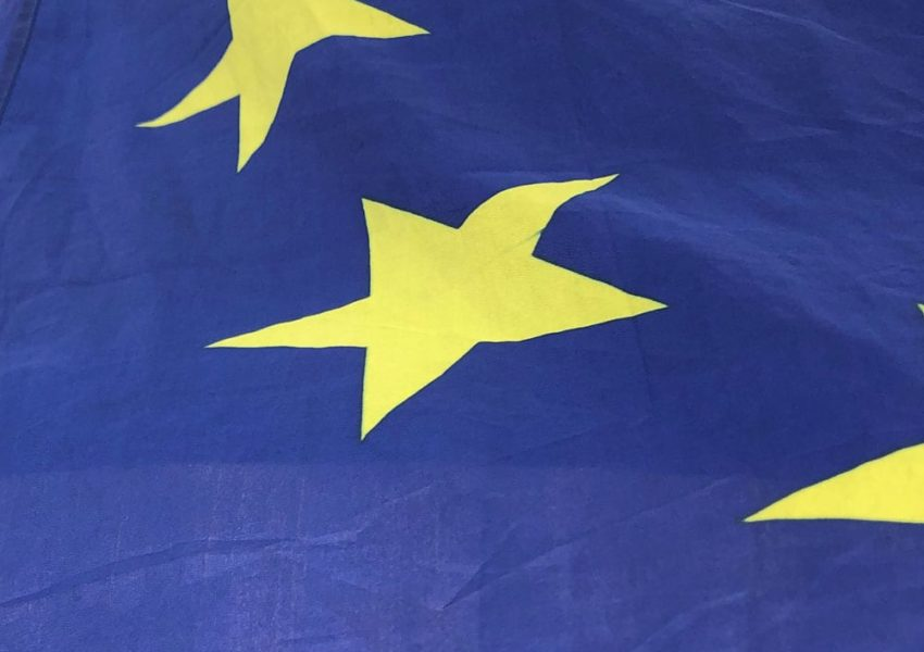 Detail of yellow stars on blue background of the European Union flag