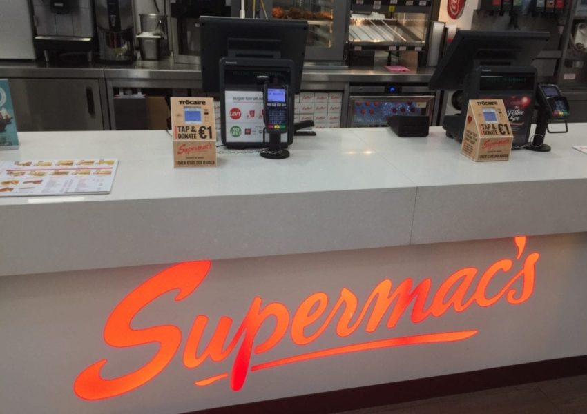 Contactless giving boxes for Trócaire on the counter at Supermac's