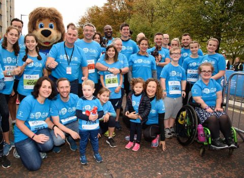 CEO Tim Johnson (back row, to the right of the lion character) with GOSH Race for the Kids participants