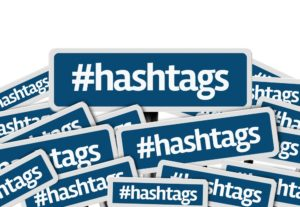 Instagram Hashtags written on multiple blue road sign