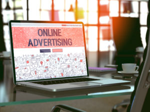 Instagram Online Advertising Concept. Closeup Landing Page on Laptop Screen in Doodle Design Style. On Background of Comfortable Working Place in Modern Office. Blurred, Toned Image. 3D Render.