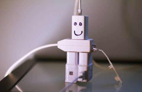 Cable charges with a smiley face