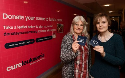 Leukaemia patient Lizzie Dean (right) and her mother Jane Young (left) with their donated plaques in front of the wall