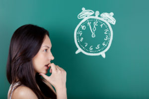 female student trying to decide best time to post on Instagram