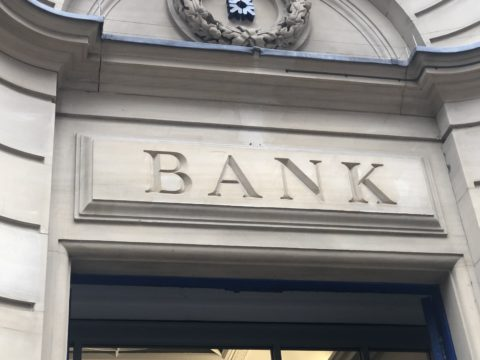 Bank sign above a doorway