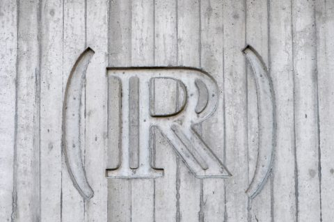 Capital letter R in black and white