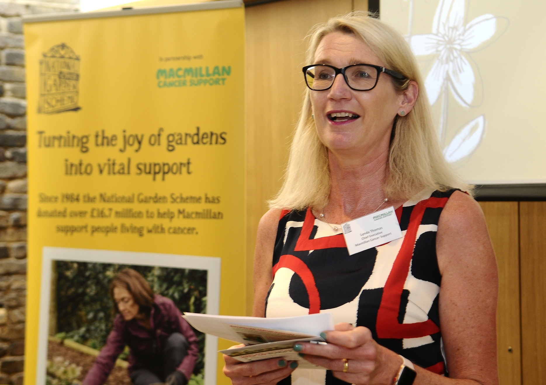 Lynda Thomas, CEO, celebrating 35 years of Macmillan Cancer Support and the National Gardens Scheme's partnership