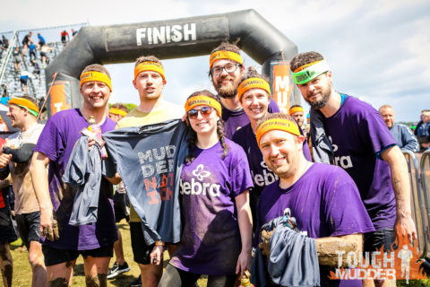 Access Group staff complete the Tough Mudder in aid of DEBRA