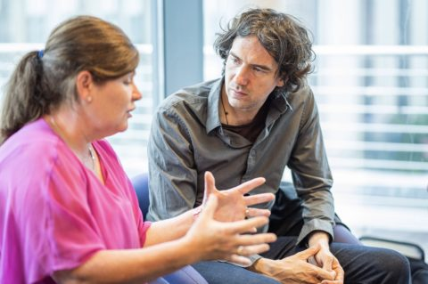 Gary Lightbody talking to a staff member from Drake Music Project NI