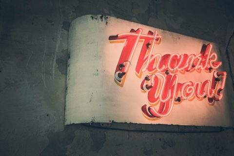 pink neon sign saying 'thank you'