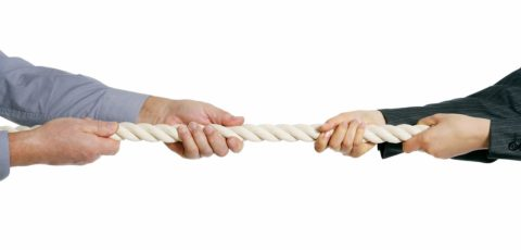 Two people and a rope in a tug of war