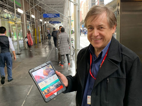 Bernard Ross on the streets of NYC with face-to-face tablet