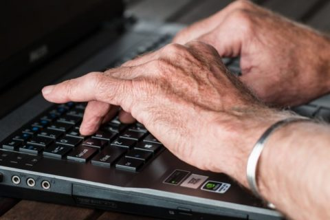 older person on computer