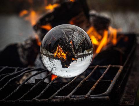 Crystal ball amid flames - photo: Unsplash