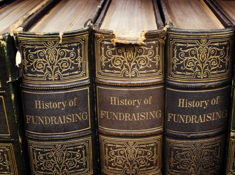 History of Fundraising book - three on a shelf
