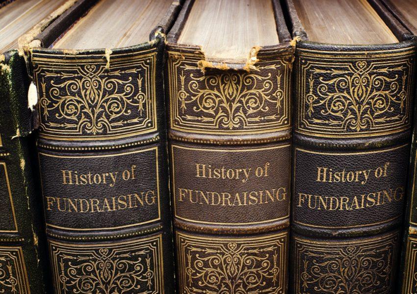 History of Fundraising book - three on a shelf