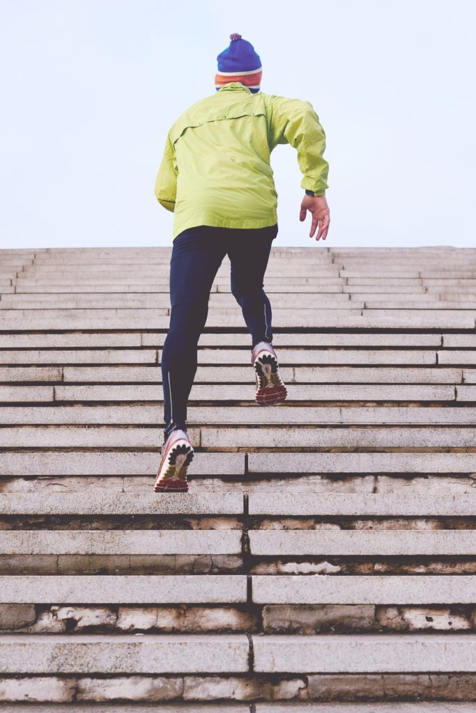 Man running up steps in running gear - unsplash.com