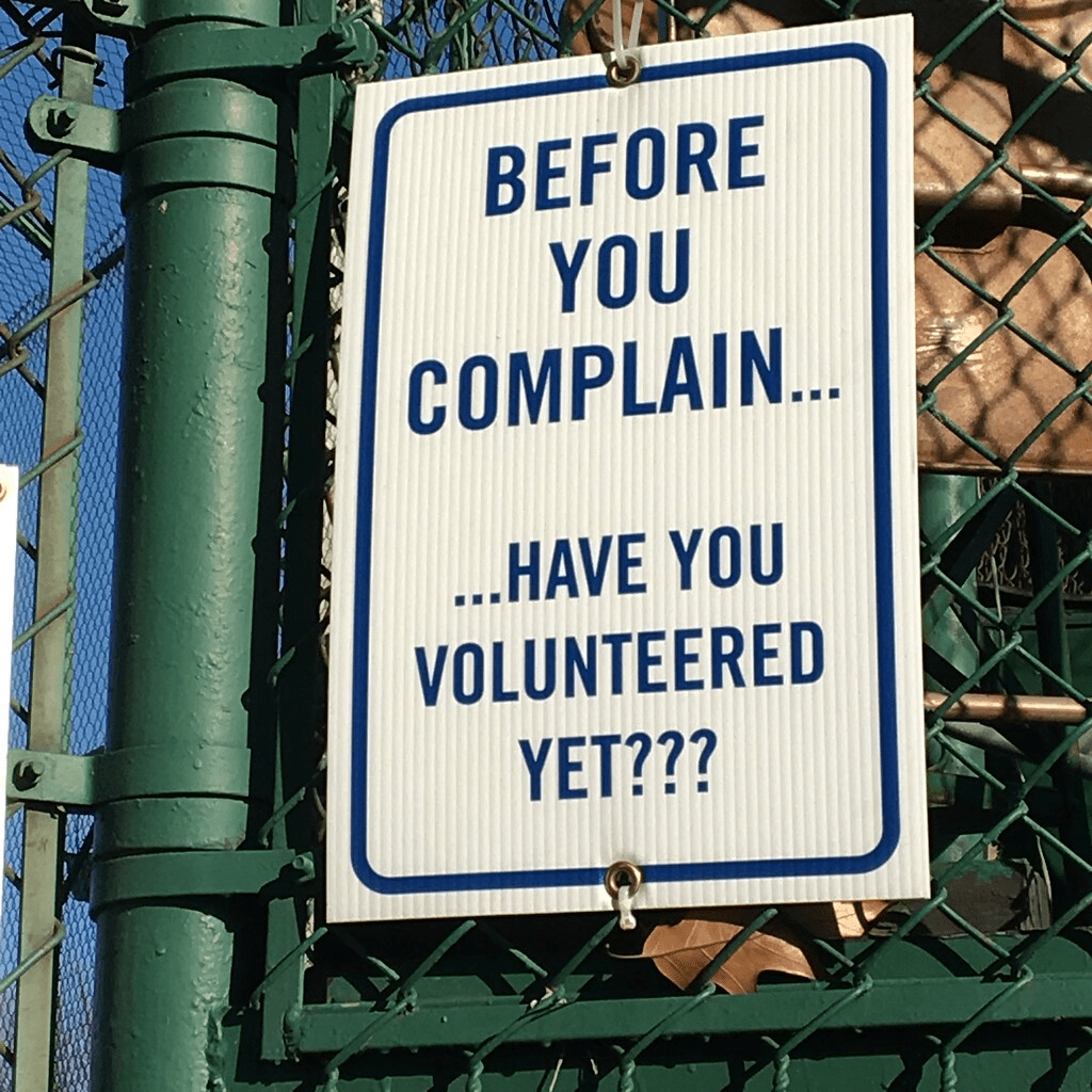 Street sign saying 'Before you complain... have you volunteered yet?'