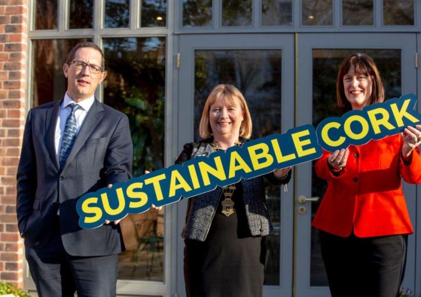 'Sustainable Cork' in cardboard held by three people