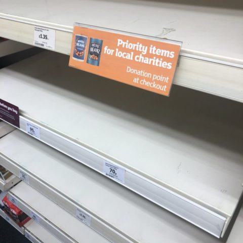 Empty shelves in Sainsburys with sign saying 'priority items for local charities' - photo: Howard Lake