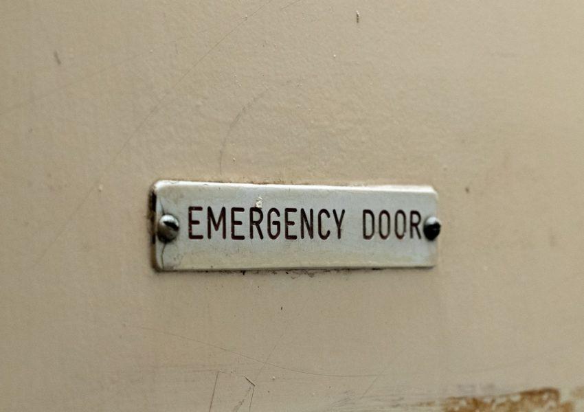 'Emergency door' sign - photo: Unsplash