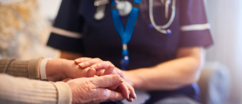 Nurse and patient holding hands - photo: Junius S Morgan Benevolent Fund