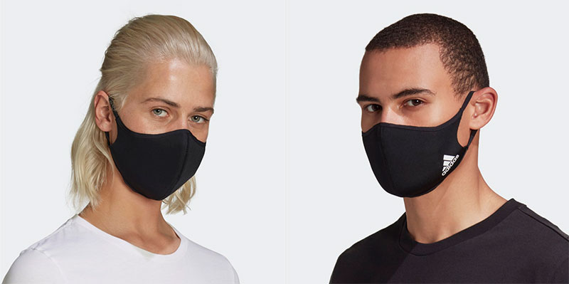 Woman and man wearing Adidas-branded face masks