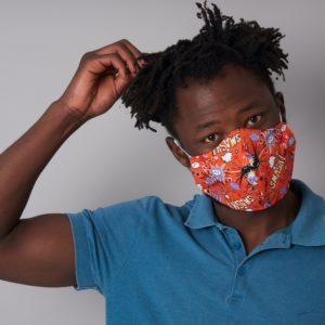 Comic design orange face mask worn by a man