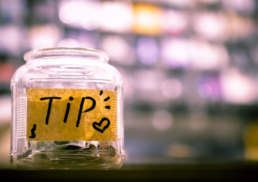 Tip jar on shop counter - photo: Unsplash