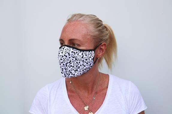 Woman wearing a WWF panda face mask