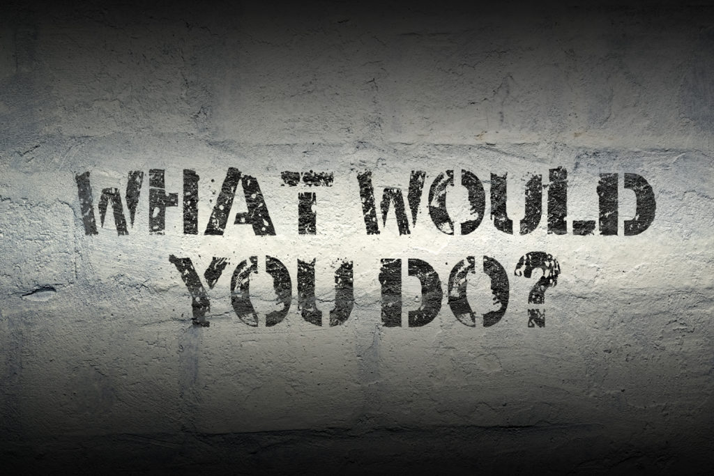 What would you do? Spray painted sign on a concrete wall