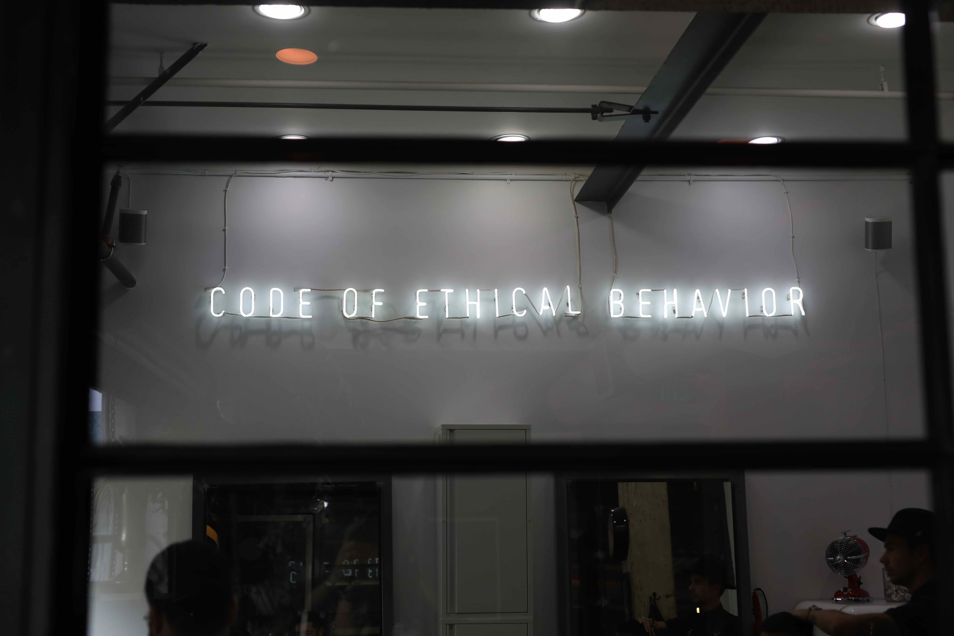 'Code of ethical behavior' neon sign - photo: Unsplash