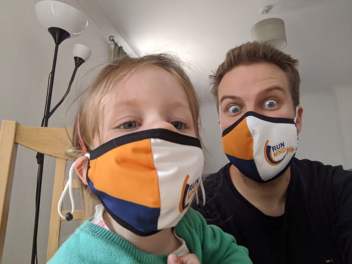 Oli Hiscoe and daughter wearing face masks