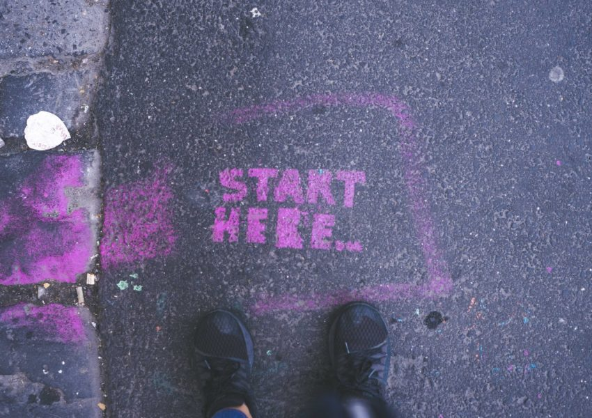 Start here - sign on the ground - photo: unsplash.com