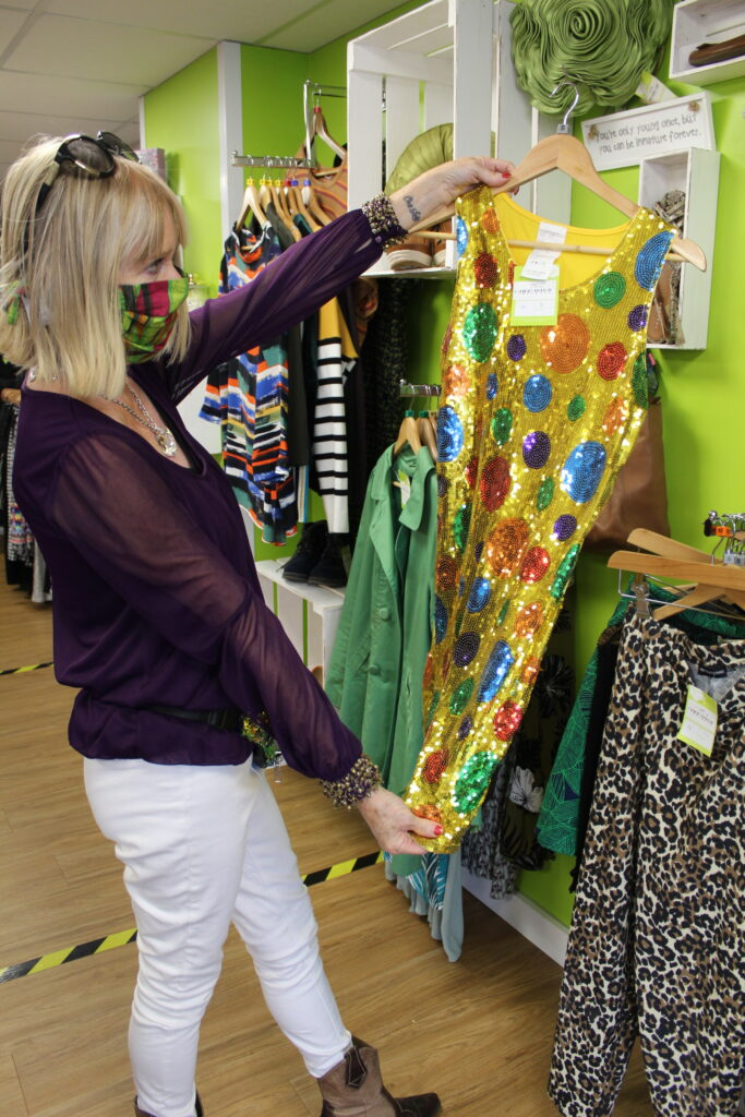 Elene Marsden exploring items for sale at St Elizabeth Hospice Heath Road charity store - CREDIT St Elizabeth Hospice
