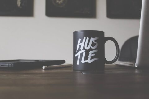 Mug with 'hustle' on the side - photo: Unsplash