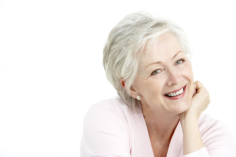 Smiling woman against a white background