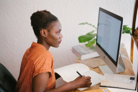 Woman at a desk learning online