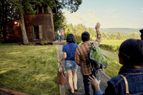 Airbnb guests wave at host