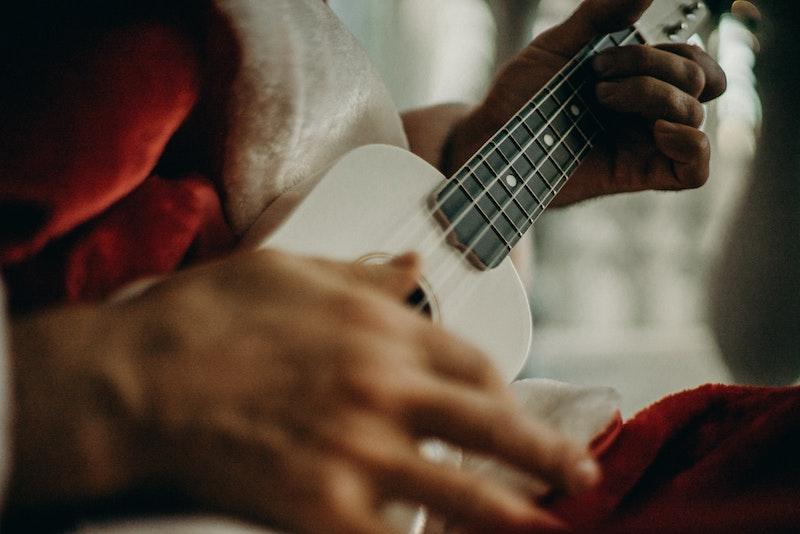 Santa plays ukulele.