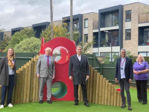 Dmitry Leus (centre) pictured with hospital staff in the revamped Children's Garden at St George's Hospital