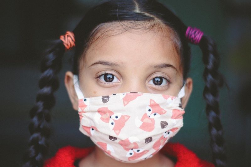 Girl in face mask