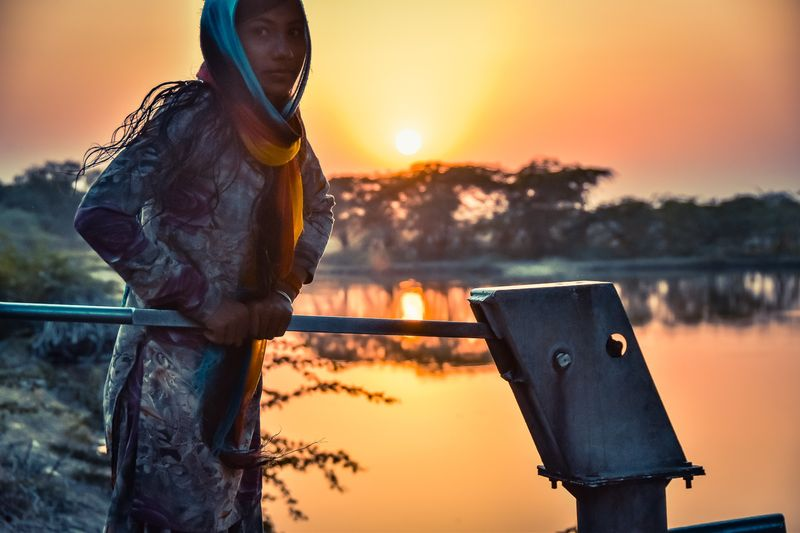 Water Harvest girl at pump